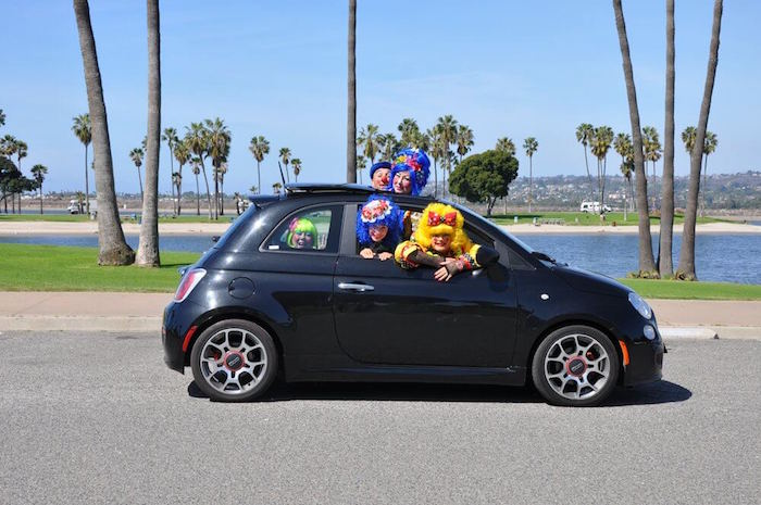 5 clowns fitting into a small fiat car