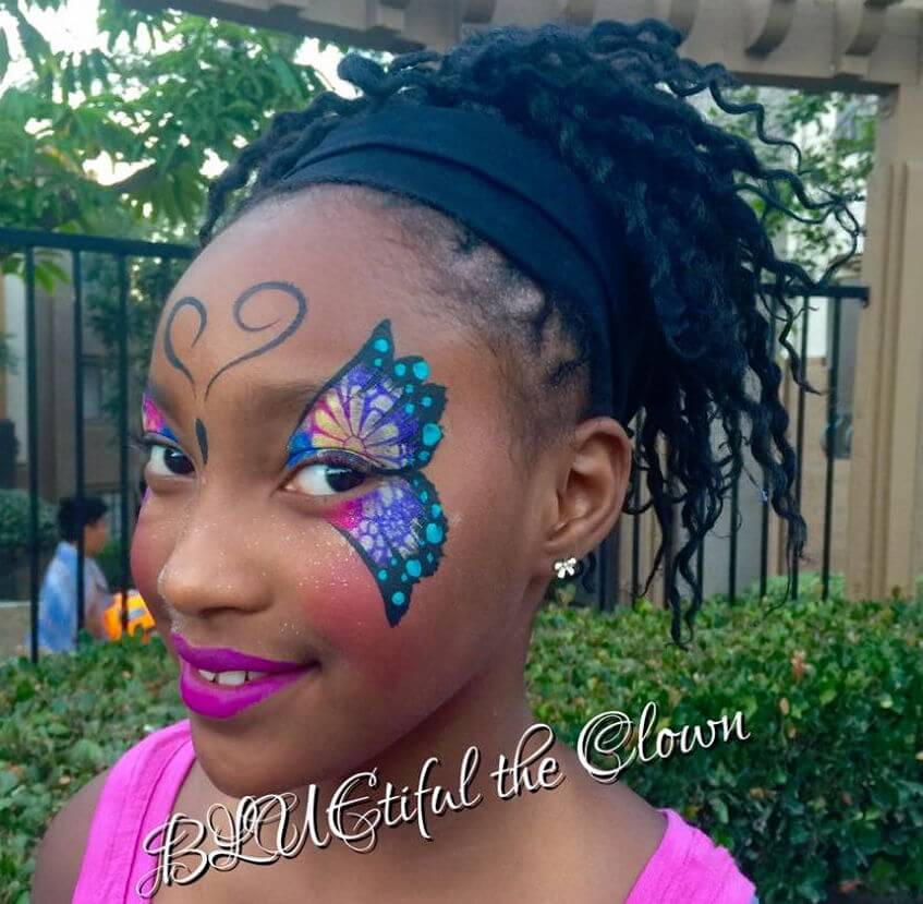 BLUEtiful with boy face painted as a cheetah