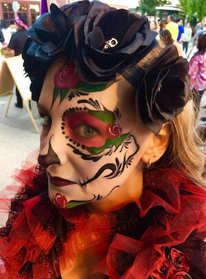 Beautiful Sugar Skull Painting on Lady with Red Collar and Black Faux Roses in Hair