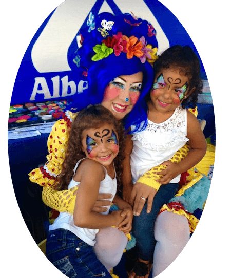 Girls with faces painted as Butterfly, Kitty and Mouse